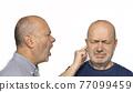 a man screaming in the ear 77099459