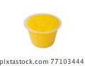 Yellow mango pudding, a close up of sweet mango mousse dessert in plastic cup isolated on white background. 77103444