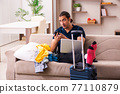 Young man preparing for journey at home 77110879