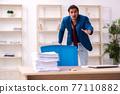 Young male employee in oversleeping concept 77110882