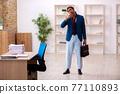 Young male employee in oversleeping concept 77110893