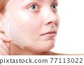 Girl woman in facial peel off mask. Skin care. 77113022