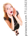 woman blonde buisnesswoman shouting isolated 77113023