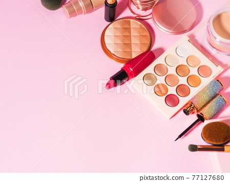 Different make up beauty cosmetics products on pink 77127680