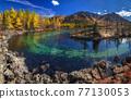 Sunrise at lake in mountain range. Beautiful reflection in water 77130053