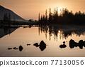 Sunrise at lake in mountain range. Beautiful reflection in water 77130056