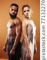 Young pretty couple diverse races together posing sensitive on brown background, lifestyle people concept 77132270
