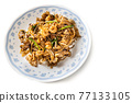 Overhead view of Penang char kuey teow is popular fried noodle with coceral, shrimp and eggs in black sauce in Malaysia 77133105