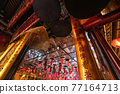Incense Coils and interior of Man Mo temple, one of the famous tourist destination in Hong Kong, China. 77164713