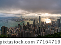 Hong Kong city skyline from Victoria peak, China with dramatic sky. 77164719