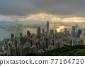 Hong Kong city skyline from Victoria peak, China with dramatic sky. 77164720