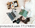 Woman reading interesting book 77174803