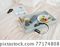 Breakfast and report on bed 77174808