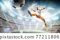 Soccer kick. A soccer player kicks the ball in air fashion. Professional soccer player in action. Stadium with flashlights and fans. 3d 77211806