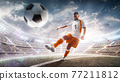 Professional soccer player in action on stadium with flashlights and fans. Kicking ball for winning goal. Wide angle. 3d 77211812