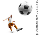 Power soccer kick. A soccer player kicks the ball. Professional soccer player in action. Isolated 77211815