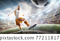 Power soccer kick. A soccer player kicks the ball in stadium. Professional soccer player in action. Wide angle. 3d 77211817