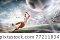 A soccer player kicks the ball. Grid of soccer gates close up. Stadium with flashlights and fans. 3d 77211834
