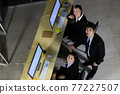 Business team relaxing after working overtime late at night in call center office. 77227507