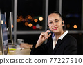 Caucasian young woman  working overtime late at night in call center office 77227510