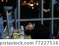 Asian lady call center worker employee sleeping on dest at night 77227516