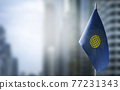 A small flag of Commonwealth on the background of a blurred background 77231343