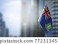 A small flag of British Virgin Islands on the background of a blurred background 77231345