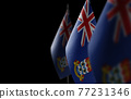 Small national flags of the Cayman Islands on a black background 77231346