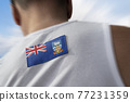 The national flag of Falkland Islands on the athlete's back 77231359