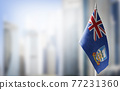 A small flag of Falkland Islands on the background of a blurred background 77231360