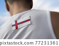 The national flag of Faroe Islands on the athlete's back 77231361