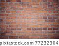 Brick brown wall of a Catholic church. 77232304