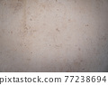 beige travertine stone background with copy space 77238694