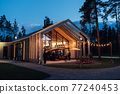 Evening illumination in the courtyard with the background of a modern wooden house 77240453