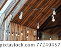 Evening illumination in the courtyard with the background of a modern wooden house 77240457