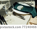 Luxurious restaurant. Luxurious interior, white tables, serving dishes and glasses for guests 77240466