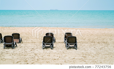 Sunbeds at the beach of Durres on Albania 77243756