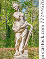Ancient decayed statue of a sensual Renaissance Era woman in the central city park of Potsdam, a German town of statues and sculptures, Germany 77244676