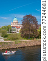 Historical downtown in Potsdam with river Havel and Saint Nikolai cathedral at blue sky in Spring, Germany 77244681