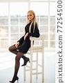 Beautiful woman wearing in black dress and black 77254500