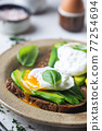 Toasted bread with poached egg 77254694
