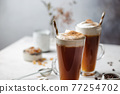 Iced coffee in a tall glass 77254702