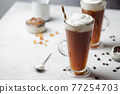Iced coffee in a tall glass 77254703