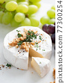 Brie or camembert cheese with walnuts and grapes 77300254
