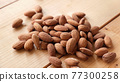 Group of almonds on wooden table background 77300258