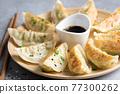 Gyoza or jiaozi fried stuffed dumplings 77300262