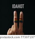V sign, rainbow flag and text IDAHOT 77307197
