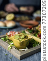 guacamole and vegan sandwiches in a tray 77307205