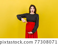 Young surprise or shocked woman pregnant isolated colored background. expression female 77308071