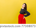 Pregnant woman with a pain in her back on colored Background isolated 77308073